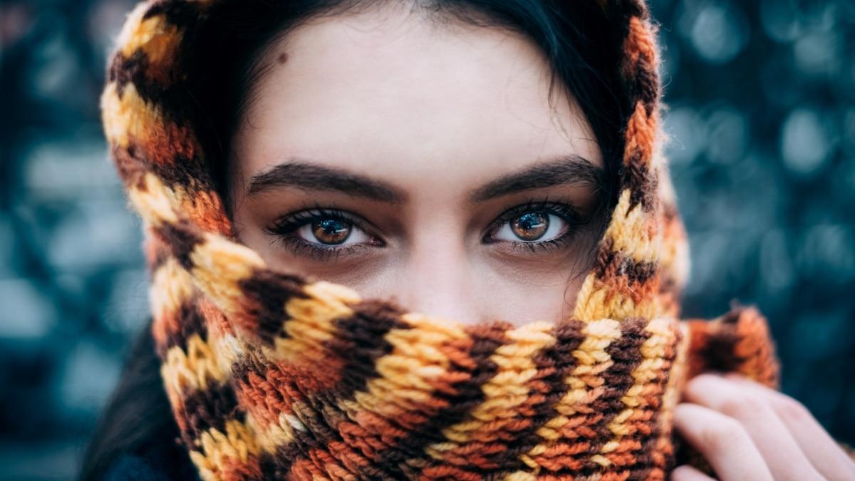 Ethnic Woman Peeking through Scarf